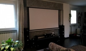 home cinema in living room with electric screen